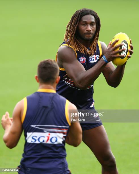 Nic Naitanui works on works on a handball drill during a West Coast Eagles AFL training session at Domain Stadium on September 11 2017 in Perth...