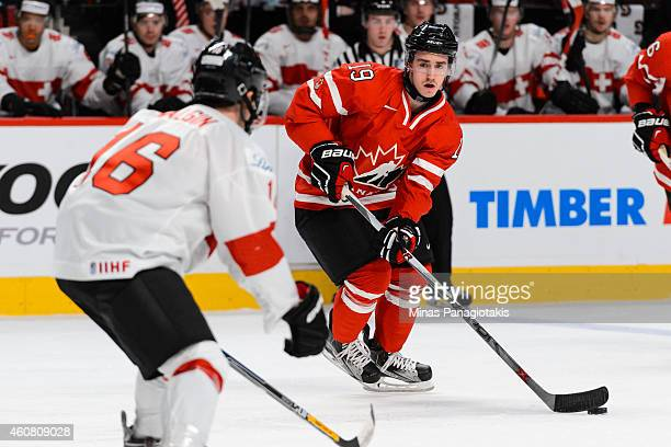 Nic Petan of Team Canada looks to play the puck during the 2015 IIHF World Junior Hockey Championship exhibition game against the Team Switzerland at...