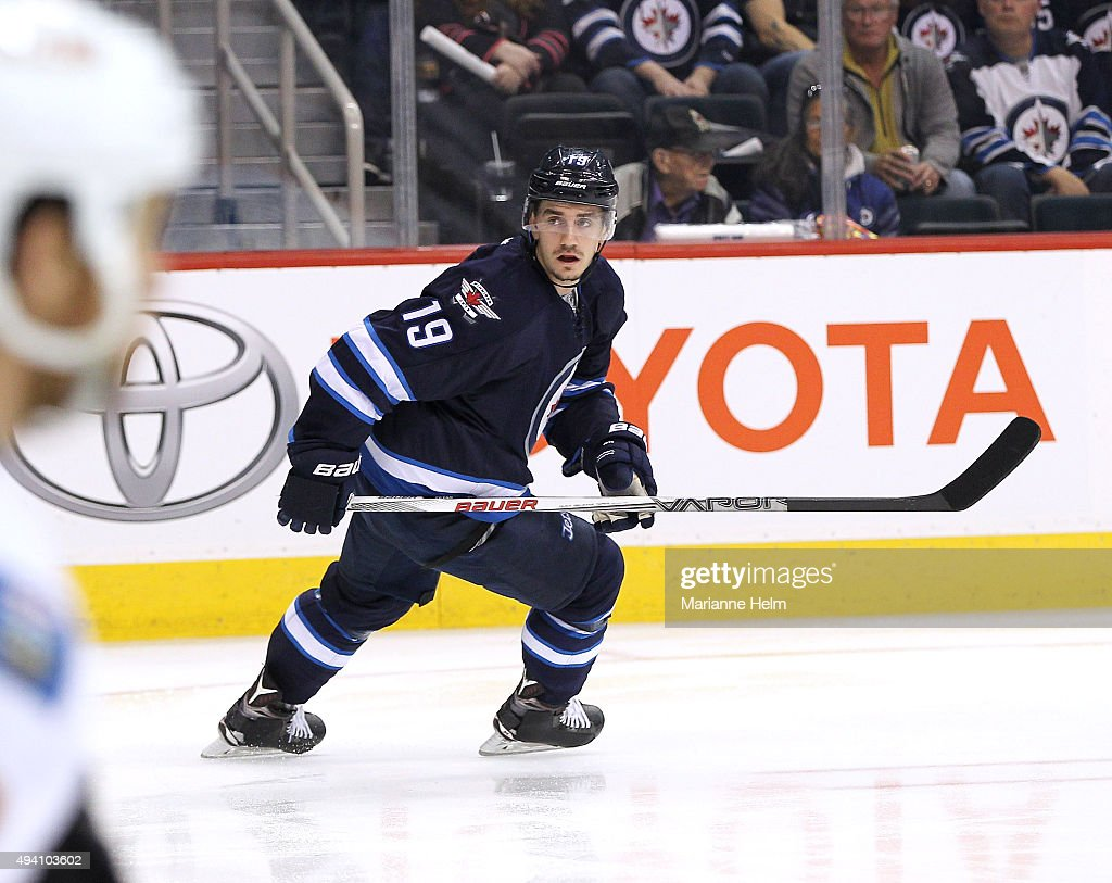 Nic Petan #19 of the Winnipeg Jets skates down the ice during second period action in an NHL game against the Calgary Flames at the MTS Centre on October 16, 2015 in Winnipeg, Manitoba, Canada.