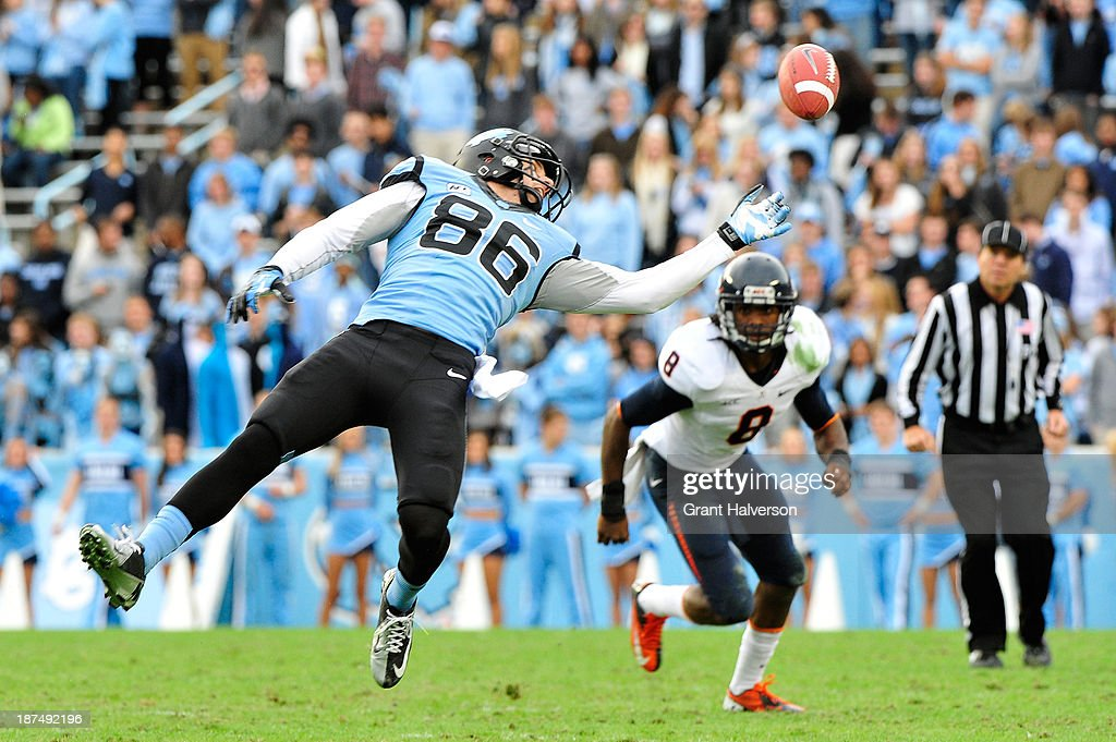Nic Platt #86 of the North Carolina Tar Heels reaches for an overthrown pass as Anthony Harris #8 of the Virginia Cavaliers defends during play at Kenan Stadium on November 9, 2013 in Chapel Hill, North Carolina. North Carolina won 45-14.