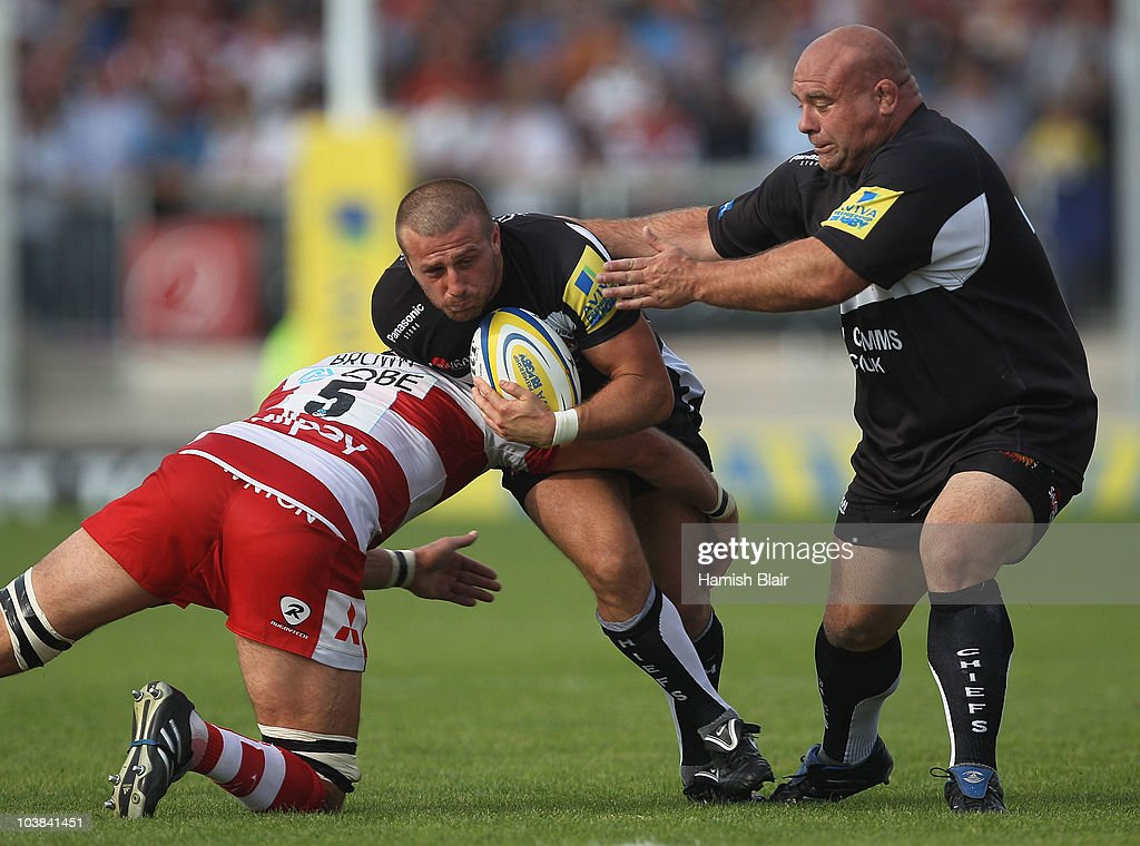 Nic Sestaret and Chris Budgen of Exeter move the ball forward under pressure from Alex Brown of Gloucester during the AVIVA Premiership match between...