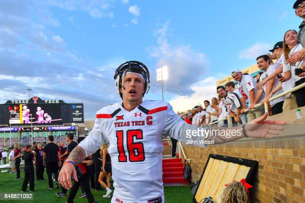Nic Shimonek of the Texas Tech Red Raiders interacts with fans before the game between the Texas Tech Red Raiders and the Arizona State Sun Devils on...