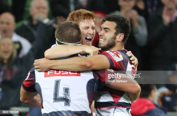 Nic Stirzaker and Jack Debreczeni of the Rebels celebrate at the full time whistle as they win the round eight Super Rugby match between the Rebels...