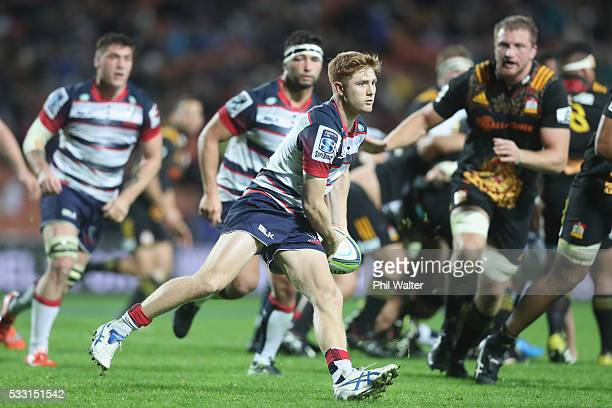 Nic Stirzaker of the Rebels looks to offload the ball during the round 13 Super Rugby match between the Chiefs and the Rebels at FMG Stadium on May...