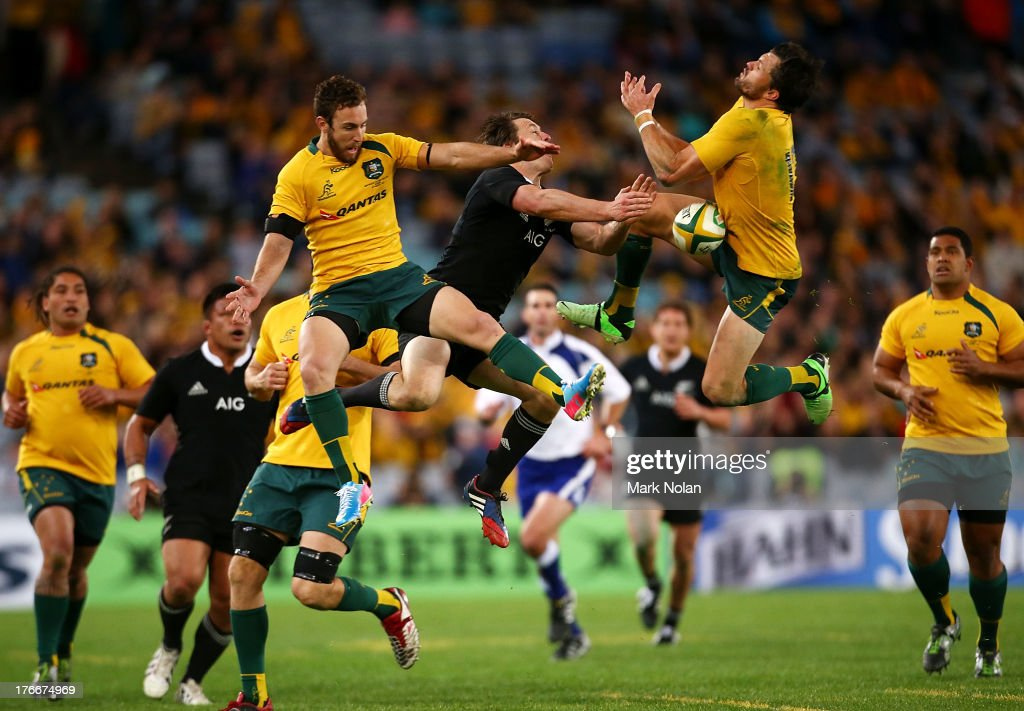 Nic White (L) and Adam Ashley Cooper (R) of the Wallabies and Ben Smith (C) of the All Blacks contest a high ball during The Rugby Championship Bledisloe Cup match between the Australian Wallabies and the New Zealand All Blacks at ANZ Stadium on August 17, 2013 in Sydney, Australia.