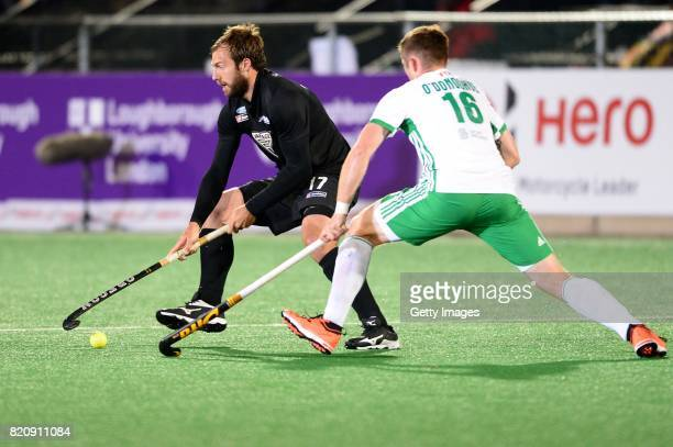 Nic Woods of New Zealand and Shane O'Donoghue of Ireland during day 8 of the FIH Hockey World League Men's Semi Finals 5th6th place match between New...