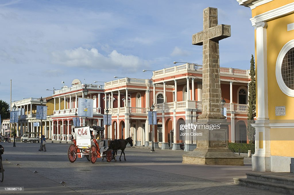 Nicaragua, Granada, Independence Plaza, Horse and carriage with colonial homes
