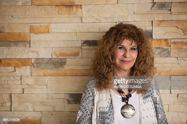 Nicaraguan author novelist and poet Gioconda Belli poses before an interview with AFP in Managua on August 23 2016 Belli referred to the upcoming...