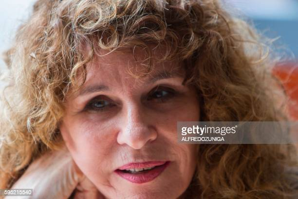 Nicaraguan author novelist and poet Gioconda Belli speaks during an interview with AFP in Managua on August 23 2016 Belli referred to the upcoming...