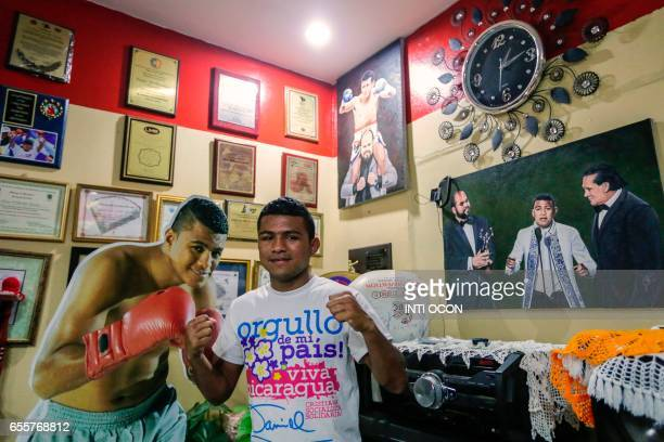 TOPSHOT Nicaraguan boxer Roman Chocolatito Gonzalez considered one of the best poundforpound fighters in the world poses for pictures at his mother's...