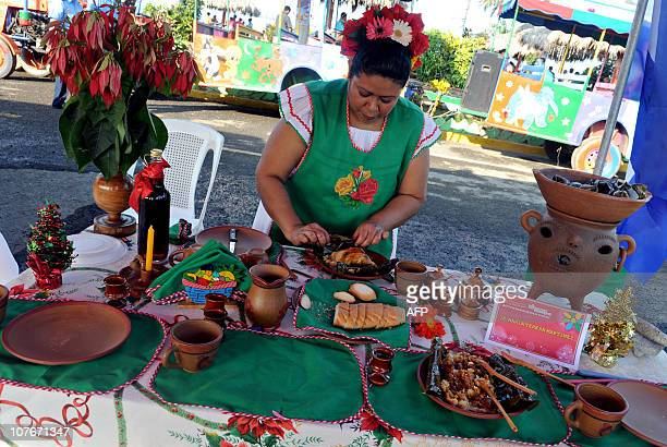 Nicaraguan cook Maria Teresa Martinez prepares a typical ''Nacatamal'' meal during a Christmas dishes contest organized by the city's mayoralty in...