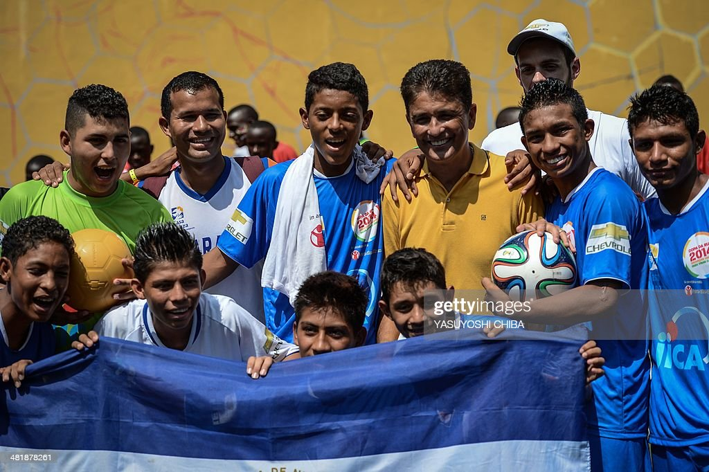 Nicaraguan players pose with Brazilian former football player Jose Roberto Gama de Oliveira aka Bebeto (yellow) during the second edition of the Street Child World Cup in Rio de Janeiro, Brazil, on April 1, 2014. About 230 boys and girls from 19 countries participate in the 10-day-long tournament.