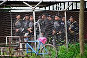 Nicaraguan policemen stand by at a checkpoint at the other side of the border in Penas Blancas Guanacaste Costa Rica in the border with Nicaragua on...