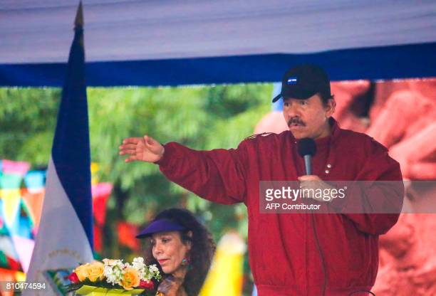 Nicaraguan President Daniel Ortega flanke by his wife and Vice President Rosario Murillo speaks to supporters in Managua on July 7 2017 during the...
