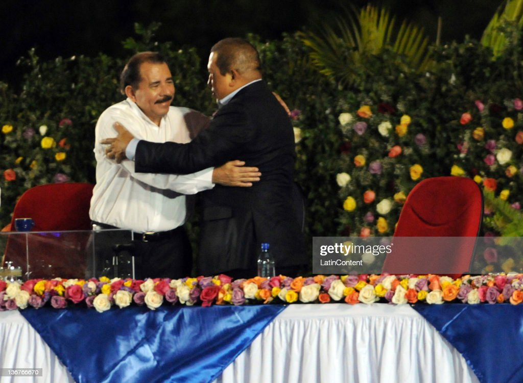 Nicaraguan president Daniel Ortega greets Hugo Chavez, from Venezuela, during the inauguration of his third term as Nicaraguan president at Revolution Square on January 10, 2012 in Managua, Nicaragua. Ortega won the elections on November 2011 with the 64 percent of the votes. He had been previously elected in 1984 and 2006.