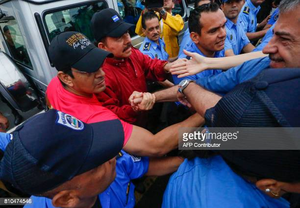 Nicaraguan President Daniel Ortega is crowded by supporters in Managua on July 7 2017 as he arrives to the celebration of the 38th anniversary of 'El...