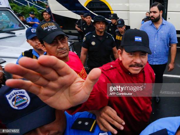 Nicaraguan President Daniel Ortega waves at supporters in Managua on July 7 2017 during the celebration of the 38th anniversary of 'El Repliegue'...