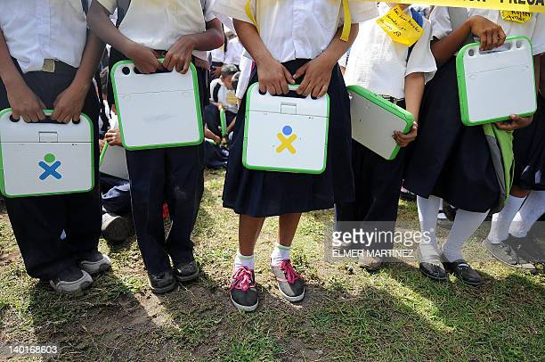 Nicaraguan schoolchildren hold their XO laptops at the municipal stadium in Ometepe Island in the Nicaragua lake south of Managua on February 29 2011...