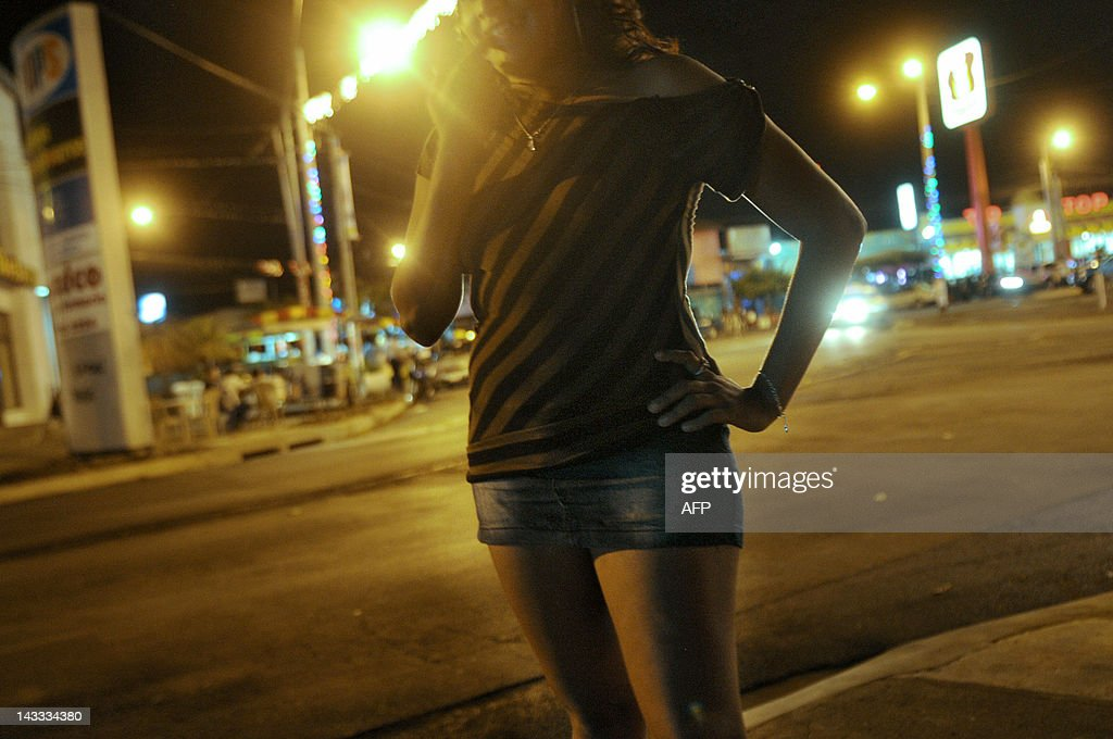 Nicaraguan sex worker and member of NGO Girasoles Nicaragua Jennifer waits for clients on a street in Managua on April 18 2012 AFP PHOTO/Elmer...