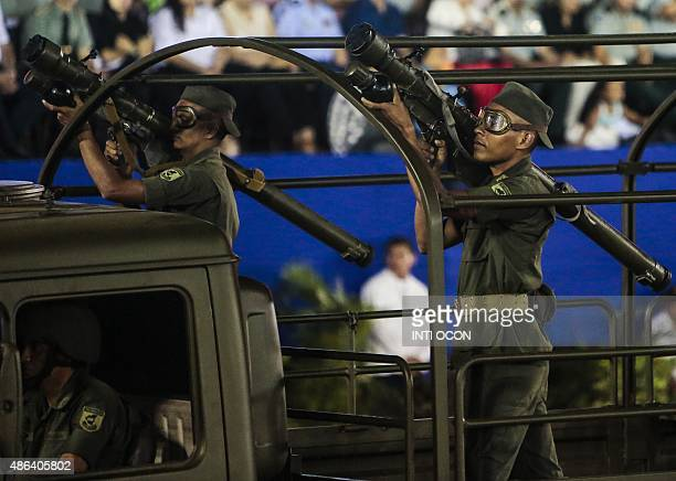 Nicaraguan soldiers stand on the back of a military lorry holding Sovietmade SAM7 shoulderlaunched surfacetoair missiles during a military a parade...