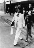 Nicaraguanborn model Bianca Jagger wears a doublebrested white suit as she and her daughter Jade walk across the street in front of a group of...