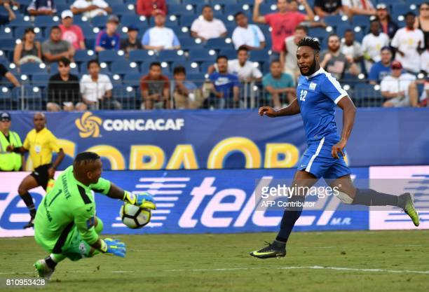 Nicaragua's goalkeeper Justo Llorente saves a shot by Martinique's Yoann Arquin during a Concacaf Gold Cup Group B match in Nashville Tennessee on...