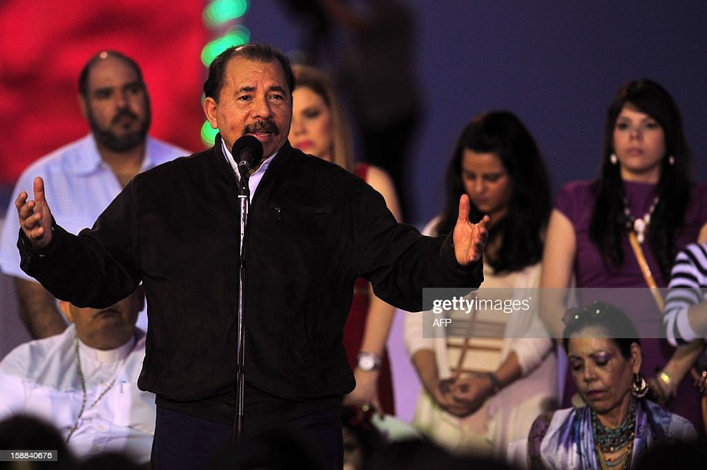 Nicaragua's President Daniel Ortega speaks during a church service that was held in the Port Salvador Allende, in Managua on December 31, 2012, to pray for the recovery of the health of President of Venezuela Hugo Chavez. AFP PHOTO/Hector Retamal