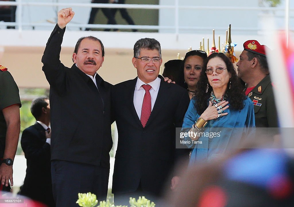 Nicaragua's President Daniel Ortega, Venezuela's Foreign Minister Elias Jaua and Ortega's wife Rosario Murillo stand before entering the funeral for Venezuelan President Hugo Chavez at the Military Academy on March 8, 2013 in Caracas, Venezuela. Countless Venezuelans have paid their last respects to Chavez and more than 30 heads of state were expected to attend the funeral today.