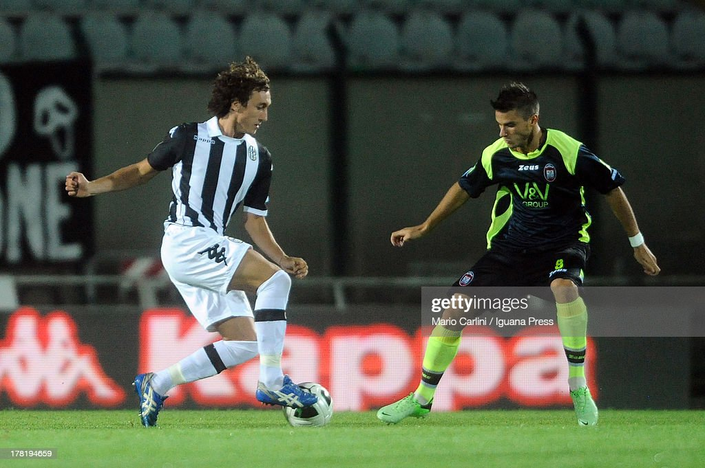 Niccolò Giannetti # 7 of AC Siena ( L ) competes the ball with Lorenzo Crisetig # 8 of FC Crotone ( R ) during the Serie B match between AC Siena and FC Crotone at Stadio Artemio Franchi on August 24, 2013 in Siena, Italy.