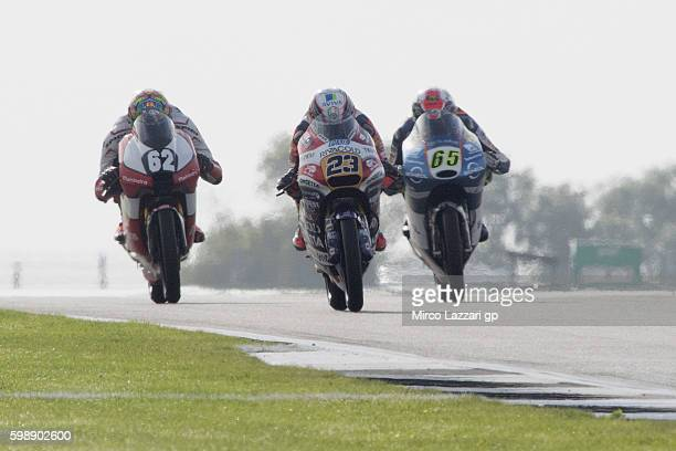 Niccolo Antonelli of Italy and Ongetta Rivacold leads the field during the MotoGp of Great Britain qualifying practice at Silverstone Circuit on...