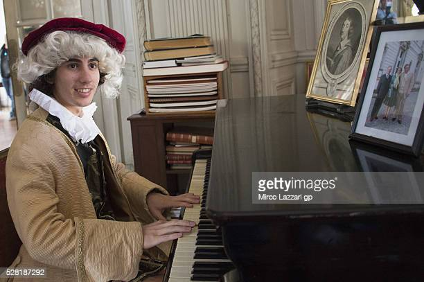 Niccolo Antonelli of Italy and Ongetta Rivacold plays the piano during a preview event at the Chateau du Lude ahead of the MotoGp of France on May 4...