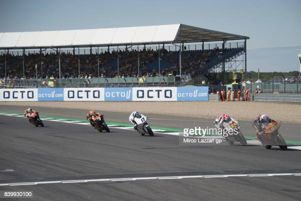 Niccolo Antonelli of Italy and Red Bull KTM Ajo leads the field during the Moto3 race during the MotoGp Of Great Britain Race at Silverstone Circuit...