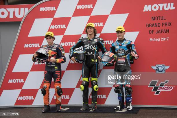 Niccolo Antonelli of Italy and Red Bull KTM Ajo Niccolo Bulega of Italy and Sky Racing Team VR46 and Aron Canet of Spain and Estrella Galicia 00...