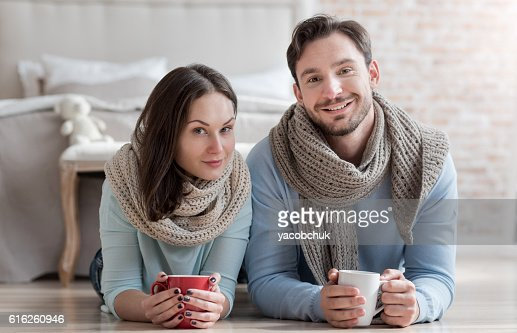 Nice attractive couple looking at you : Stock Photo