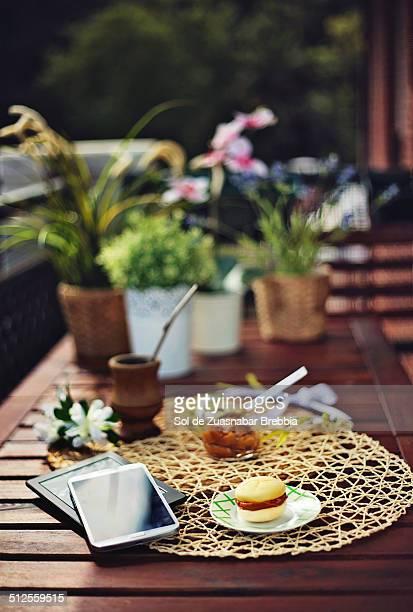 Nice breakfast on a balcony.Tablet, ebook & sweets