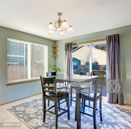 Nice dinning room with carpet and windows. : Stock Photo