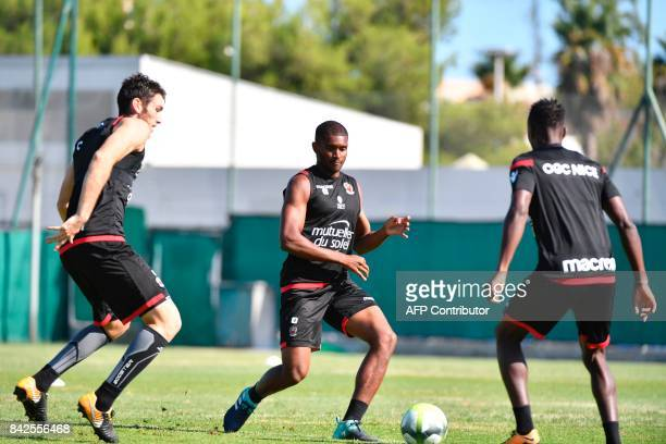OGC Nice football club's new recruit Brazilian defender Santos Marlon and teammates take part in a training session on September 4 2017 at the...