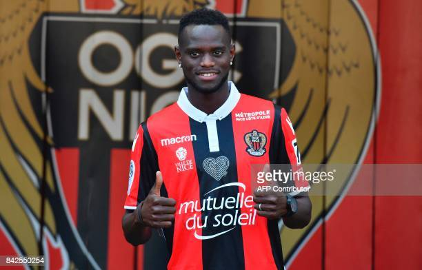 OGC Nice football club's new recruit Senegalese defender Racine Coly poses with his new jersey during the official presentation of the club's new...
