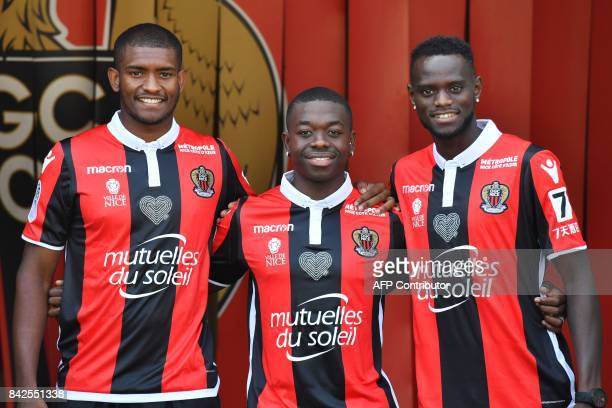 OGC Nice football club's new recruits Brazilian defender Santos Marlon French midfielder Nampalys Mendy and Senegalese defender Racine Coly pose with...