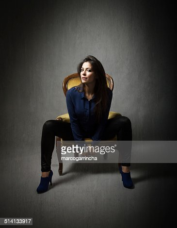 Nice Girl Sitting With Open Legs On Yellow Sofa