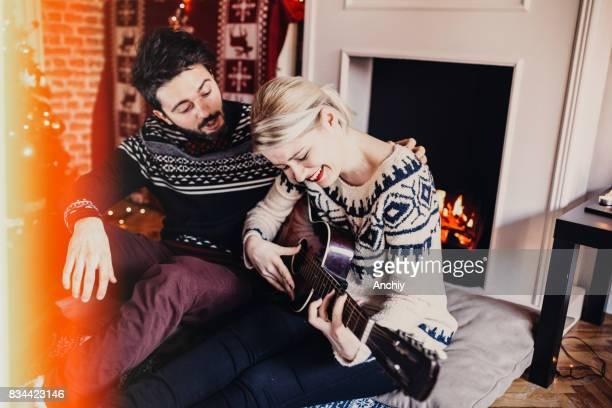 Nice job. Husband learning his wife to play guitar.