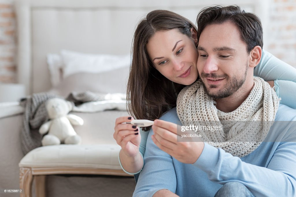 Nice joyful couple recovering from an illness : Stock Photo