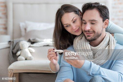 Nice joyful couple recovering from an illness : Foto de stock