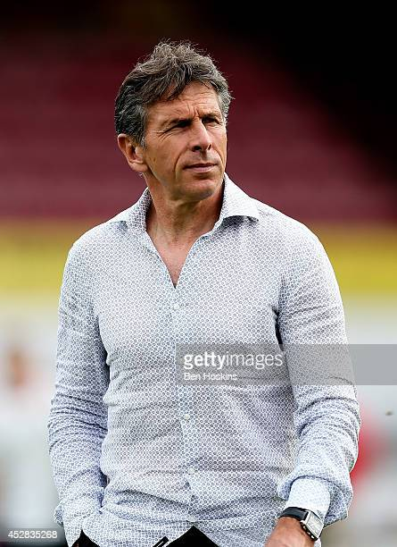 Nice manager Claude Puel looks on ahead of the Pre Season Friendly between Brentford and Nice at Griffin Park on July 26 2014 in Brentford England