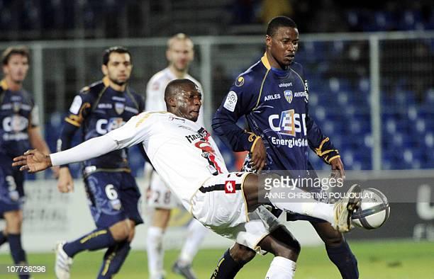 Nice midfielder Abdou Traore vies with ArlesAvignon forward Ndiaye Deme Ndiaye during their French L1 football match ArlesAvignon vs Nice on December...