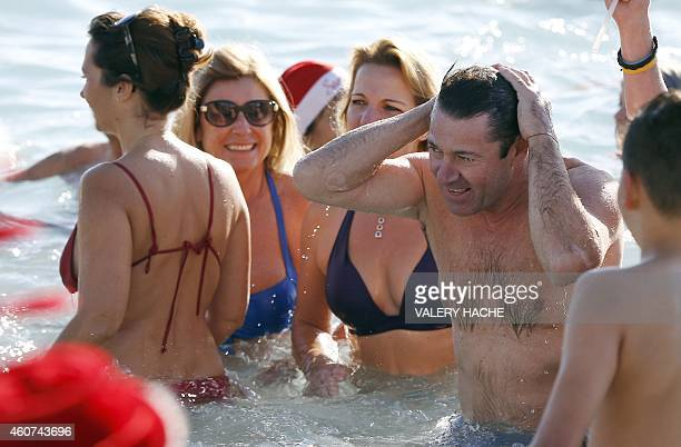 Nice rightwing UMP mayor Christian Estrosi takes part in the traditional Christmas bath on December 21 2014 on the beach in downtown Nice AFP PHOTO /...
