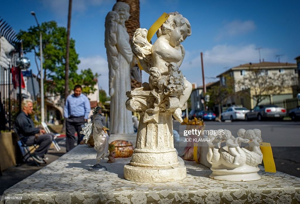 A nice variety of angels and other items wait to be discovered by potential buyers at a garage sale in mid-city of Los Angeles on on March 22, 2014. AFP PHOTO/JOE KLAMAR