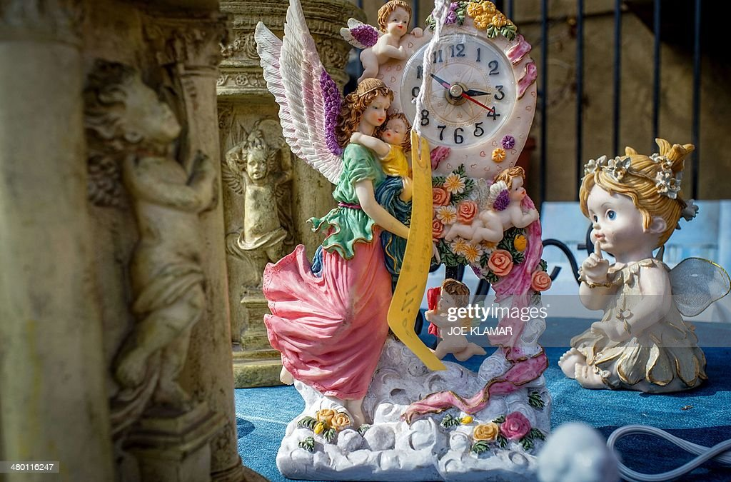 A nice variety of angels and other items wait to be discovered by potential buyers at a garage sale in mid-city of Los Angeles on March 22, 2014.