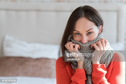 Nice young woman holding her scarf : Foto de stock