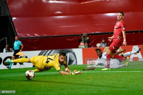 Nice's Allan SaintMaximin scores despite of Zulte Waregem's goalkeeper during the UEFA Europa League Group K football match between SV Zulte Waregem...